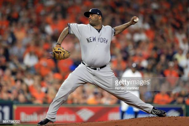 Sabathia of the New York Yankees throws a pitch against the Houston Astros during the first inning in Game Seven of the American League Championship...