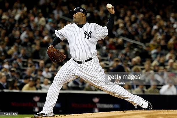 C Sabathia of the New York Yankees throws a pitch against the Philadelphia Phillies in Game One of the 2009 MLB World Series at Yankee Stadium on...