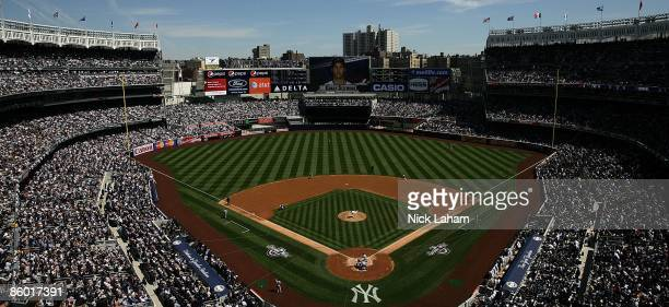 Sabathia of the New York Yankees throws the first pitch against the Cleveland Indians during opening day at the new Yankee Stadium on April 16 2009...