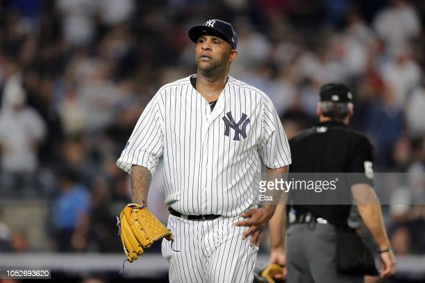 Sabathia of the New York Yankees walks back to the dugout at the end of the first inning against the Boston Red Sox during Game Four American League...