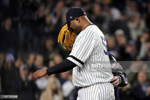 Sabathia of the New York Yankees walks off the field as he comes out of the game against the Houston Astros during the eighth inning in game four of...