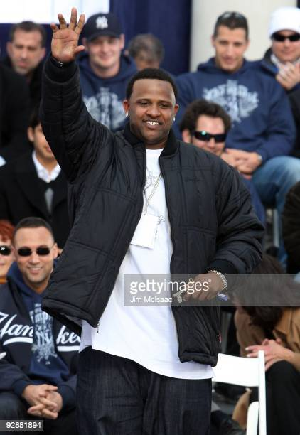 Sabathia of the New York Yankees waves to the crowd after accepting his key to the city at the New York Yankees World Series Victory Celebration at...