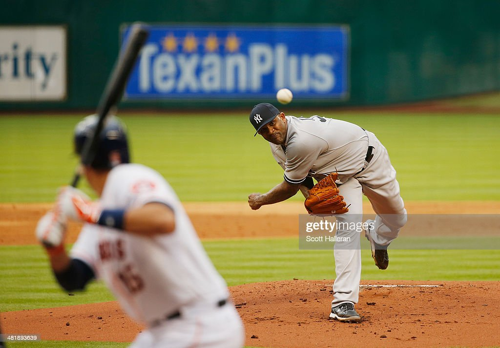 C.C. Sabathia #52 of the the New York Yankees throws a pitch in the first inning to Jose Altuve #27 of the Houston Astros during the game at Minute Maid Park on April 1, 2014 in Houston, Texas.