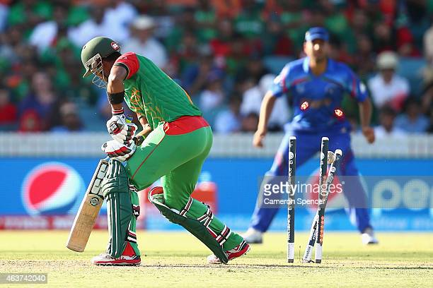 Sabbir Rahman of Bangladesh is dismissed by Hamid Hassan of Afghanistan during the 2015 ICC Cricket World Cup match between Bangladesh and...