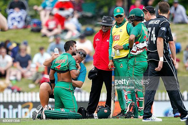 Sabbir Rahman of Bangladesh receives attention during the third One Day International match between New Zealand and Bangladesh at Saxton Field on...