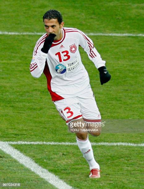 Sabeur Frej of Tunisia's club Etoile Sahel reacts after he scored a goal by penelty kick during the playoff for the third place against Japan's Urawa...