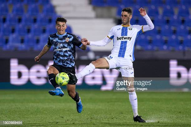 Sabin Merino of CD Leganes battle for the ball with Aitor Bunuel of UD Almeria during the La Liga Smartbank match between CD Leganes and UD Almeria...