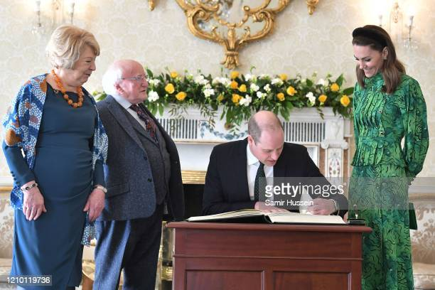 Sabina Coyne President of Ireland Michael D Higgins and Catherine Duchess of Cambridge watch as Prince William Duke of Cambridge signs a the...