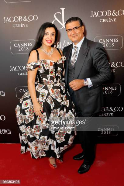 Sabina Hajieva and Jacob Arabo attend the Jacob Co Cannes 2018 party at Nikki Beach on May 16 2018 in Cannes France