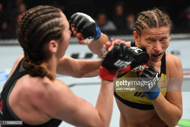 Sabina Mazo of Colombia punches Maryna Moroz of Ukraine in their women's flyweight bout during the UFC Fight Night event at Wells Fargo Center on...