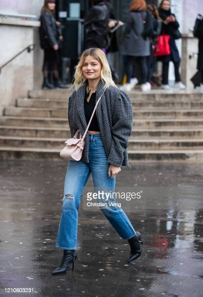 Sabina Socol is seen wearing cropped top ripped denim jeans, checkered grey jacket outside Akris during Paris Fashion Week - Womenswear Fall/Winter...