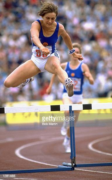 Sabine Busch of East Germany in action during a Womens Hurdles event of the East Berlin Grand Prix at the Olympic Stadium in East Germany Mandatory...