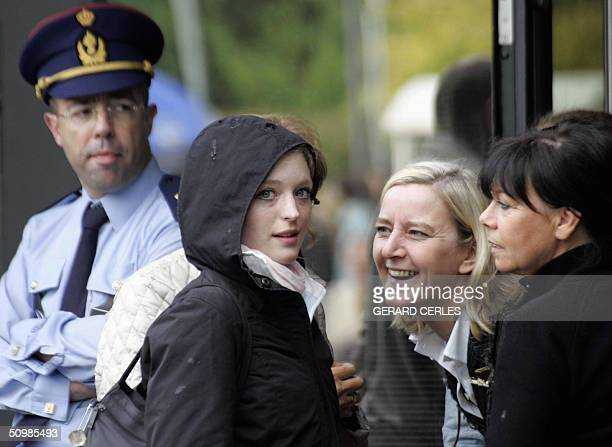 Sabine Dardenne smiles outside Arlon's assize court at the end of the trial of Marc Dutroux 22 June 2004 After the jury deliberated for 3 days...
