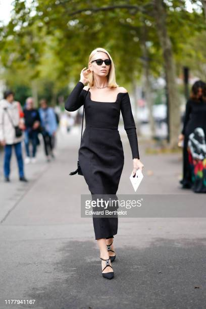 Sabine Getty wears sunglasses a black dress outside Valentino during Paris Fashion Week Womenswear Spring Summer 2020 on September 29 2019 in Paris...