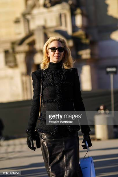 Sabine Getty wears sunglasses a black jacket with floral embroidery a black leather skirt outside Chanel during Paris Fashion Week Haute Couture...