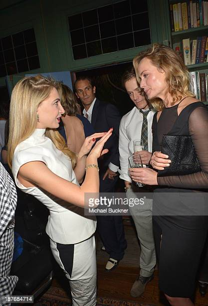 Sabine Ghanem and Amber Valetta attend the Sabine G Jewelry Dinner at Balthazar and Rosetta Getty's home on November 8 2013 in Los Angeles California
