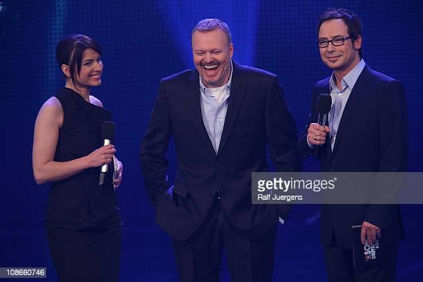 Sabine Heinrich Stefan Raab and Matthias Opdenhoevel perform during the TV show 'Unser Song fuer Deutschland' on January 31 2011 in Cologne Germany