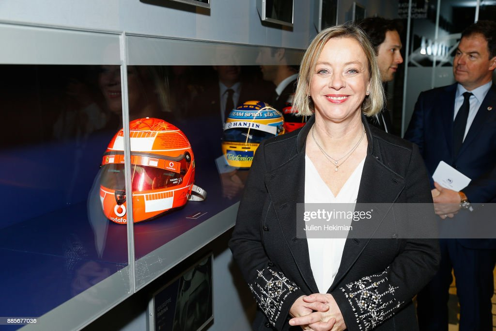 Sabine Kehm, in charge of the Michael Schumacher's family communication is pictured with the Michael Schumacher helmet during the FIA Hall of Fame Induction ceremony at Automobile Club De France on December 4, 2017 in Paris, France.