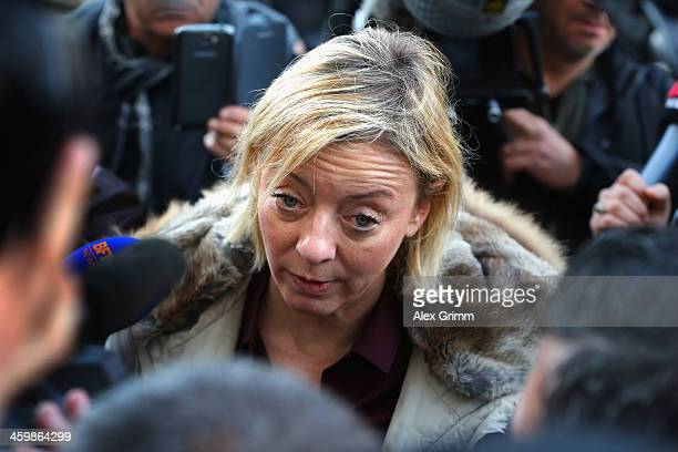 Sabine Kehm press officer of former German Formula One driver Michael Schumacher talks to the media outside the Grenoble University Hospital Centre...