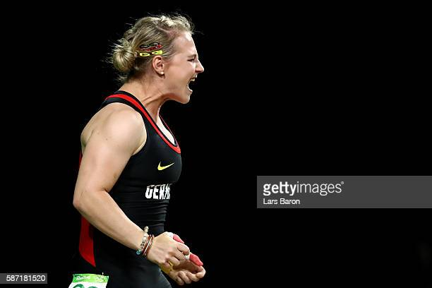 Sabine Kusterer of Germany reacts during the Women's 58kg Group B weightlifting contest on Day 3 of the Rio 2016 Olympic Games at the Riocentro...
