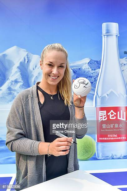 Sabine Liscki of Germany poses for a picture during an event held at Kunlun Water booth during the 2016 China Open at the China National Tennis...