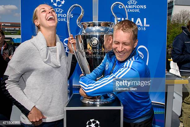 Sabine Lisicki and Oliver Pocher pose with the cup during the UEFA Champions League Trophy Tour Berlin on April 29 2015 in Berlin Germany