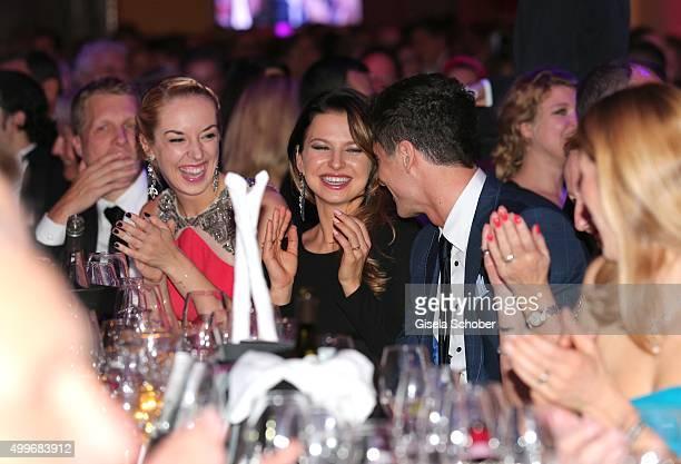 Sabine Lisicki Anna Lewandowski and Robert Lewandowski during the Audi Generation Award 2015 at Hotel Bayerischer Hof on December 2 2015 in Munich...