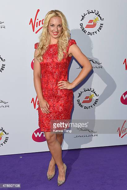 Sabine Lisicki attends the WTA PreWimbledon Party at Kensington Roof Gardens on June 25 2015 in London England