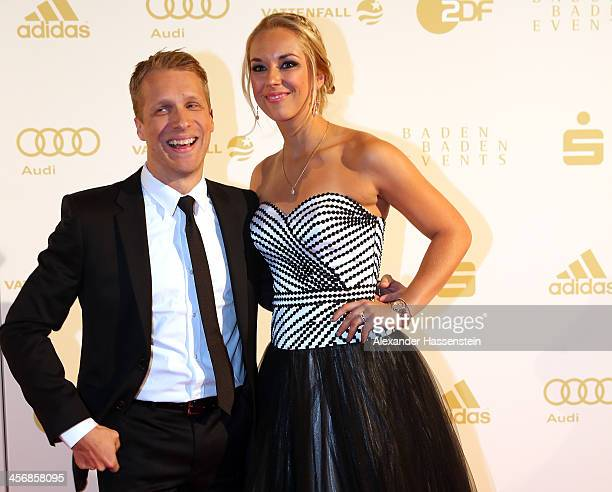 Sabine Lisicki attends with Oliver Pocher the Sportler des Jahres 2013 gala at the Kurhaus BadenBaden on December 15 2013 in BadenBaden Germany