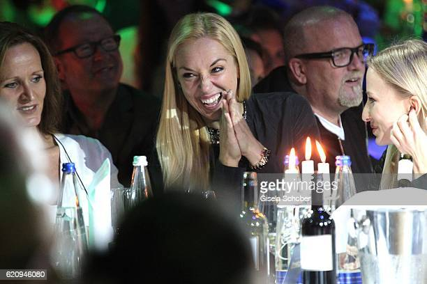 Sabine Lisicki laughs during the VIP premiere of Schubeck's Teatro at Spiegelzelt on November 3 2016 in Munich Germany