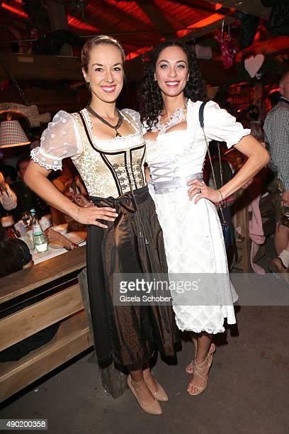 Sabine Lisicki Lilly Becker wearing a Claudia Effenberg dirndl during the Oktoberfest 2015 at Kaeferschaenke at Theresienwiese on September 26 2015...
