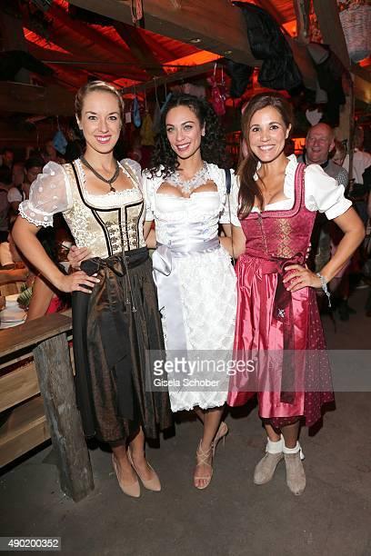 Sabine Lisicki Lilly Becker wearing a Claudia Effenberg dirndl Karen Webb during the Oktoberfest 2015 at Kaeferschaenke at Theresienwiese on...
