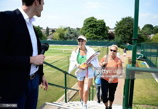 Sabine Lisicki of Germany and Barbara Rittner captain of the German Fed Cup team leave a practice session on day eleven of the Wimbledon Lawn Tennis...