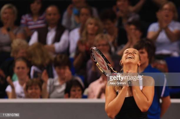 Sabine Lisicki of Germany celebrates afetr winning her first round match against Dominika Cibulkova of Slovakia at the Porsche Tennis Grand Prix at...