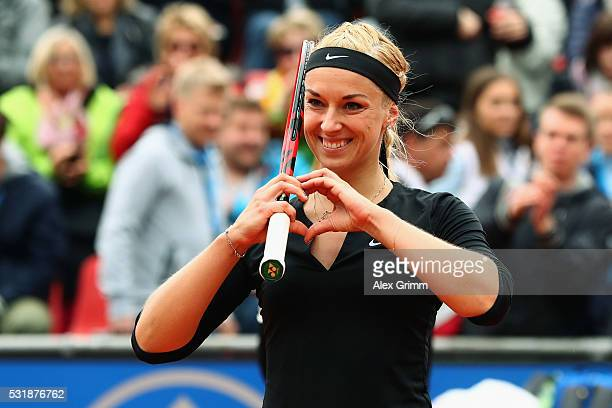 Sabine Lisicki of Germany celebrates after defeating Laura Arruabarrena of Spain during day four of the Nuernberger Versicherungscup 2016 on May 17...