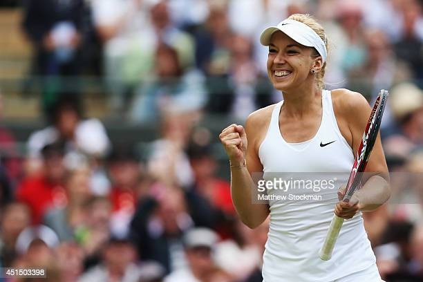 Sabine Lisicki of Germany celebrates after winning her Ladies' Singles fourth round match against Ana Ivanovic of Serbia on day seven of the...
