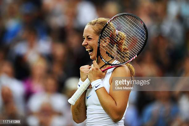 Sabine Lisicki of Germany celebrates after winning her second round match against Na Li of China on Day Four of the Wimbledon Lawn Tennis...
