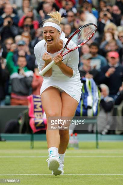 Sabine Lisicki of Germany celebrates match point during her Ladies' singles fourth round match against Maria Sharapova of Russia on day seven of the...