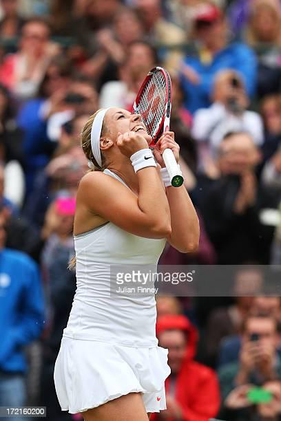Sabine Lisicki of Germany celebrates match point during the Ladies' Singles quarterfinal match against Kaia Kanepi of Estonia on day eight of the...