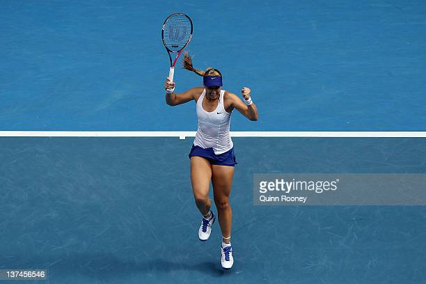 Sabine Lisicki of Germany celebrates match point in her third round match against Svetlana Kuznetsova of Russia during day six of the 2012 Australian...