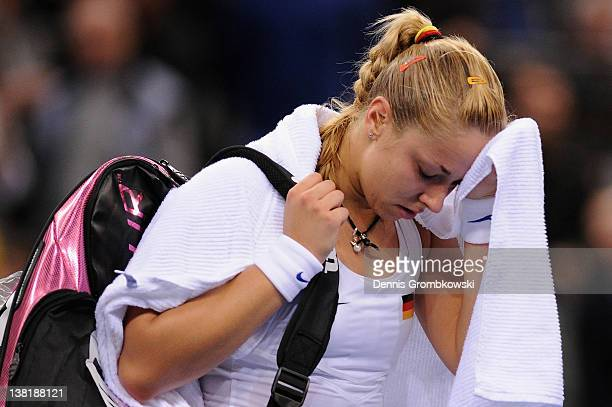 Sabine Lisicki of Germany cries after losing her single match against Iveta Benesova of Czech Republic during day one of the Federation Cup 2012...