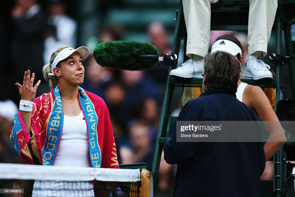 Sabine Lisicki of Germany gestures as she talks to umpire Jake Garner as play is suspended during her Ladies' Singles third round match against Ana Ivanovic of Serbia on day six of the Wimbledon Lawn Tennis Championships at the All England Lawn Tennis and Croquet Club at Wimbledon on June 28, 2014 in London, England.
