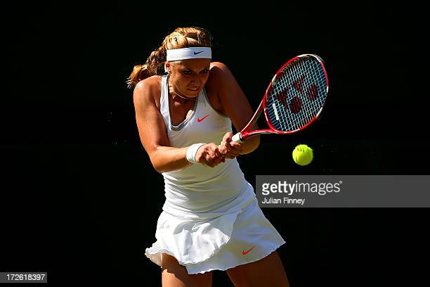 Sabine Lisicki of Germany hits a backhand during the Ladies' Singles semi final match against Agnieszka Radwanska of Poland on day ten of the...