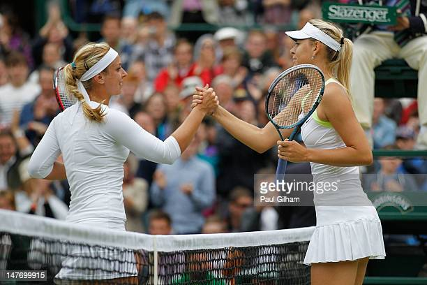 Sabine Lisicki of Germany is congratulated by Maria Sharapova of Russia after their Ladies' singles fourth round match on day seven of the Wimbledon...