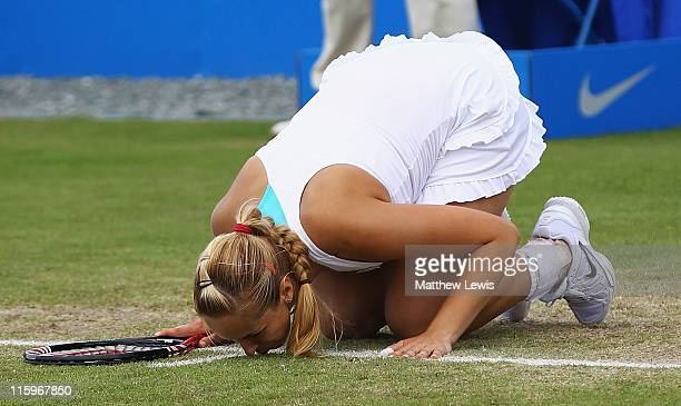 Sabine Lisicki of Germany kisses the court after she defeated Daniela Hantuchova of Slovakia in the Ladies Final during day eight of the AEGON...