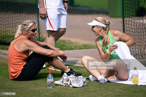 Sabine Lisicki of Germany laughs as she talks with Barbara Rittner captain of the German Fed Cup team during a practice session on day eleven of the...