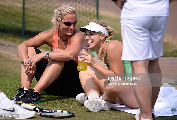 Sabine Lisicki of Germany laughs as she talks with Barbara Rittner, captain of the German Fed Cup team during a practice session on day eleven of the...