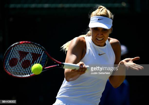 Sabine Lisicki of Germany plays a backhand against Anna Kalinskaya of Russia during Wimbledon Championships Qualifying Day 2 at The Bank of England...