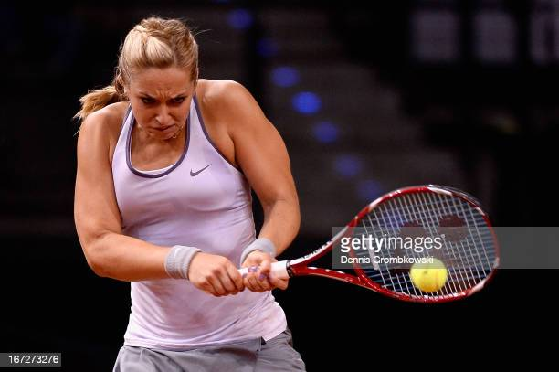 Sabine Lisicki of Germany plays a backhand in her match against Nastassja Burnett of Italy during Day 2 of the Porsche Tennis Grand Prix at...
