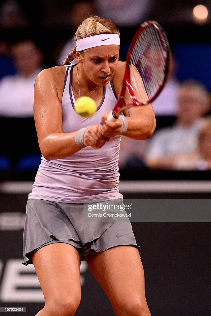 Sabine Lisicki of Germany plays a backhand in her match against Jelena Jankovic of Serbia during Day 4 of the Porsche Tennis Grand Prix at Porsche-Arena on April 25, 2013 in Stuttgart, Germany.